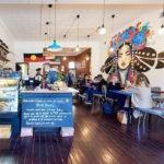 Cafe australien répondant de manière satisfaisante à 18% de «taxe de l'homme»